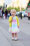 Little girl eating ice cream walking in the city Stock Photos