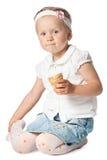 Little girl eating icecream on white Stock Image