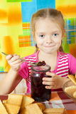 Little girl eating jam Stock Photo