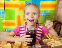 Little girl eating jam Royalty Free Stock Image