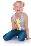 Little girl eating a juicy banana Royalty Free Stock Photos