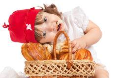 Little girl eating a loaf of bread Royalty Free Stock Image