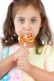 Little girl eating lollipop Royalty Free Stock Images
