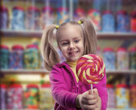 Little girl eating lollipop Royalty Free Stock Photo