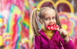Little girl eating lollipop Stock Photos
