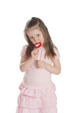 Little girl eating lollipops Royalty Free Stock Images