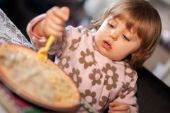 Little girl eating lunch Stock Photography