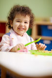 Little girl eating lunch in kindergarten Royalty Free Stock Images