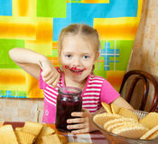 Little girl eating marmalade Royalty Free Stock Images
