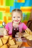 Little girl eating marmalade Stock Photos