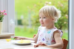 Little girl eating mashed potatoes Royalty Free Stock Photos