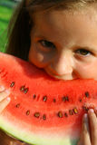 Little girl eating melon Stock Photo
