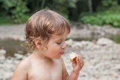 Little girl eating melon. Royalty Free Stock Photos