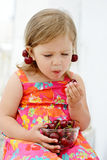 Little girl eating merry Royalty Free Stock Photo