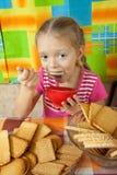 Little girl eating milk dessert Royalty Free Stock Image