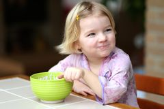 Little girl eating muesli with yogurt for breakfast Stock Photo