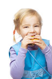 Little girl eating muffin Stock Photography
