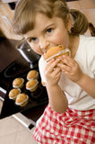 Little girl eating muffin Royalty Free Stock Photos