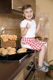 Little girl eating muffin Royalty Free Stock Photo