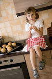 Little girl eating muffin Stock Photo