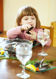 Little girl eating mussels Royalty Free Stock Image