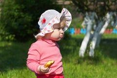 Little girl eating Stock Images