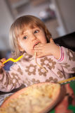 Little girl eating pasta Royalty Free Stock Photo
