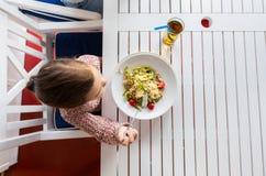 Little girl eating pasta for dinner at restaurant Royalty Free Stock Photos