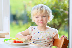 Little girl eating pasta for lunch Stock Photography