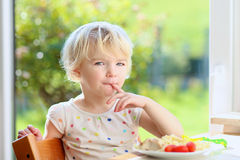 Little girl eating pasta for lunch Stock Photos