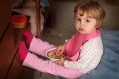 Little girl eating pasta Stock Image