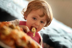 Little girl eating pasta Royalty Free Stock Photos