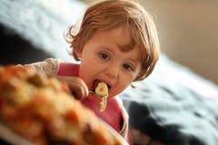 Little girl eating pasta Royalty Free Stock Photos