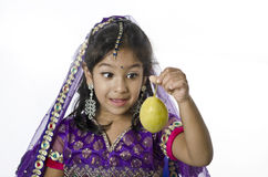 Little Girl eating Pears Stock Photos