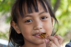 Little girl eating Pimp Royalty Free Stock Image