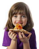 A little girl eating a pizza Stock Photography