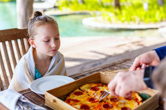 Little girl eating pizza Royalty Free Stock Image