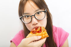 Little girl eating pizza Stock Photography
