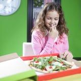 Little girl eating pizza Stock Photo
