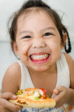 Little girl eating. Royalty Free Stock Photography