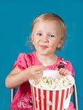 Little girl eating popcorn Royalty Free Stock Photos