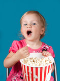 Little girl eating popcorn Royalty Free Stock Photo