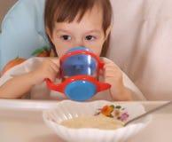 Little girl eating Stock Photos