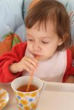Little girl eating Stock Images