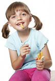 Little girl eating a potato chips Royalty Free Stock Photo