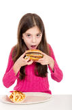 Little girl eating potatoes. Little girl eating hamburger on withe background Royalty Free Stock Photos