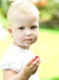 Little girl eating raspberry Royalty Free Stock Photography