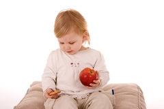 Little girl eating red apple Stock Photography