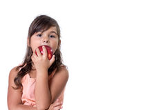 Little girl is eating a red apple Stock Image