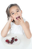 Little girl eating red fruit Stock Photo